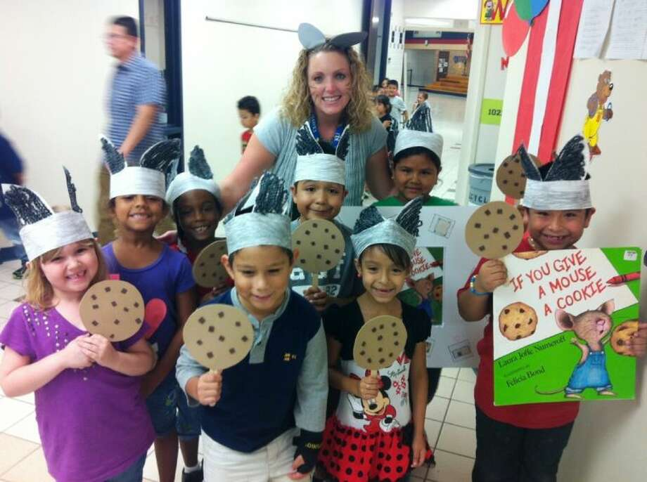 """Armstrong Elementary first-grade teacher Mrs. Toms reads """"If You Give A Mouse A Cookie."""""""