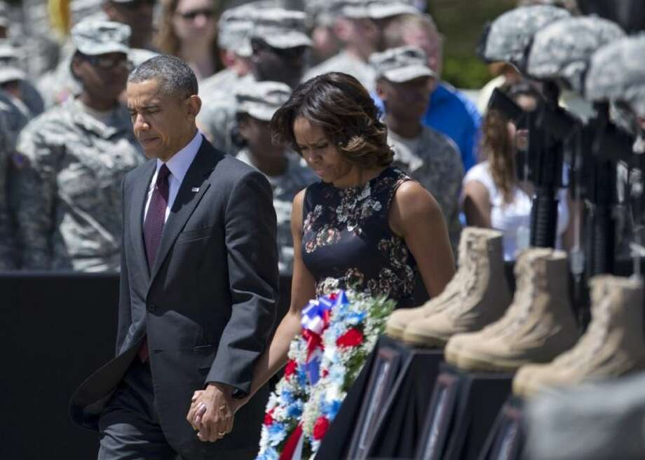 President Barack Obama and first lady Michelle Obama arrive for a memorial ceremony Wednesday at Fort Hood for those killed there in a shooting last week.