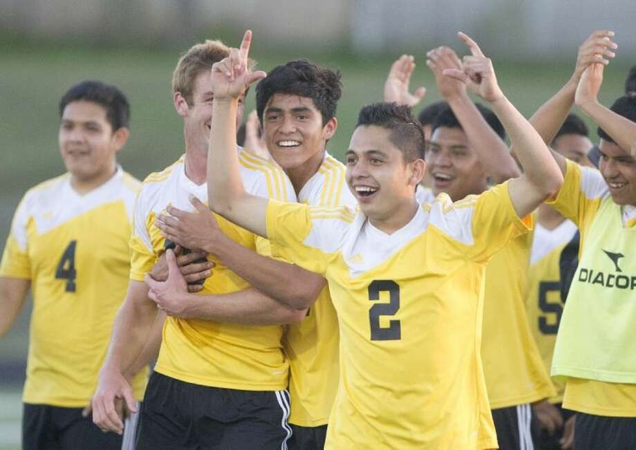 Juan Vargas leads the Conroe Tigers in celebration after a 2-1 win over Westwood gave them a berth in the Region II-5A Tournament for the first time since 1997. Photo: Jason Fochtman