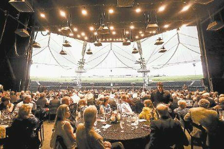 Attendees enjoy dinner during The Pavilion Partners Wine Dinner and Auction March 22, 2015, at The Cynthia Woods Mitchell Pavilion. The 18th annual event, honoring John Robichau, will be hosted March 20. Photo: Michael Minasi