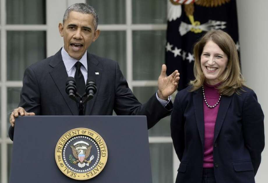 President Barack Obama, stands with his nominee to become Health and Human Services secretary, Budget Director Sylvia Mathews Burwell, while speaking in the Rose Garden of the White House in Washington Friday, where he made the announcement.