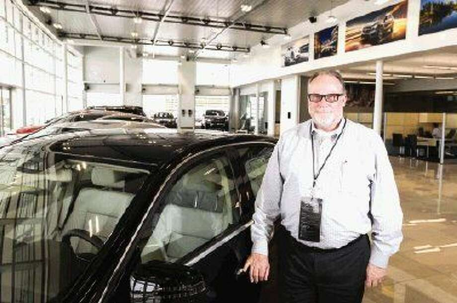 Co-owner Bob Milner poses for a portrait at the new Mercedes-Benz of The Woodlands during its official opening to the public Monday.