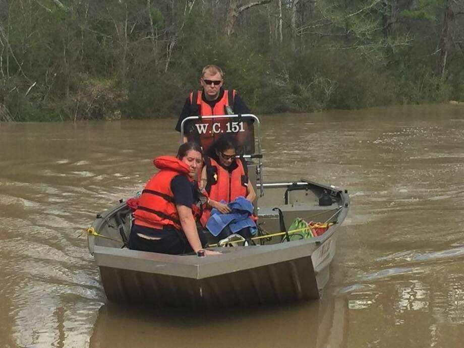 East Montgomery County firefighters rescued about 15 residents from eight flooded homes Saturday off FM 1485 at the East Fork of the San Jacinto River as the area experienced flooding.