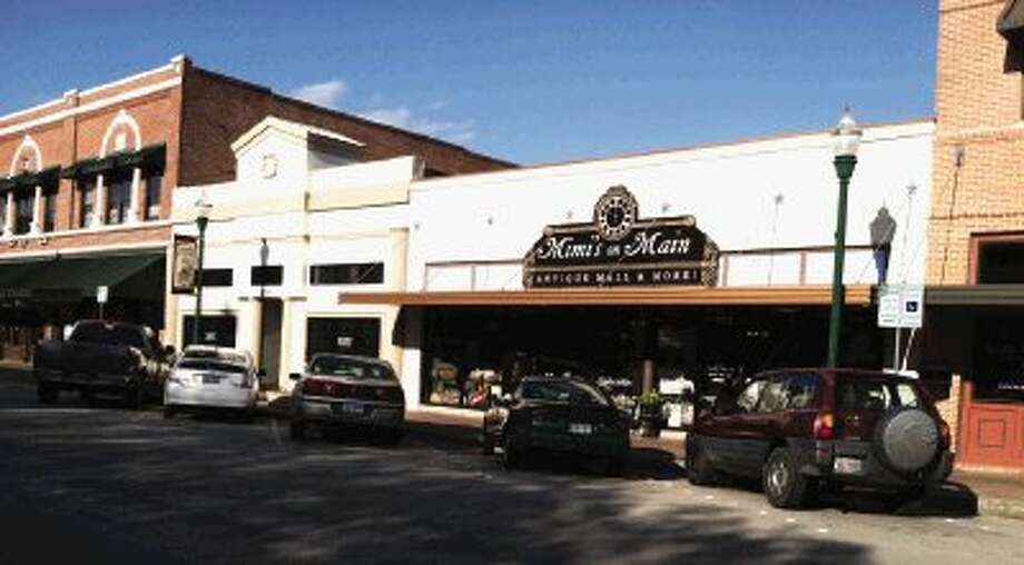 The 318 Main Law Offices, left and Mimi's on Main Antique Mall and more, right, present day on Main Street on the square in downtown Conroe.