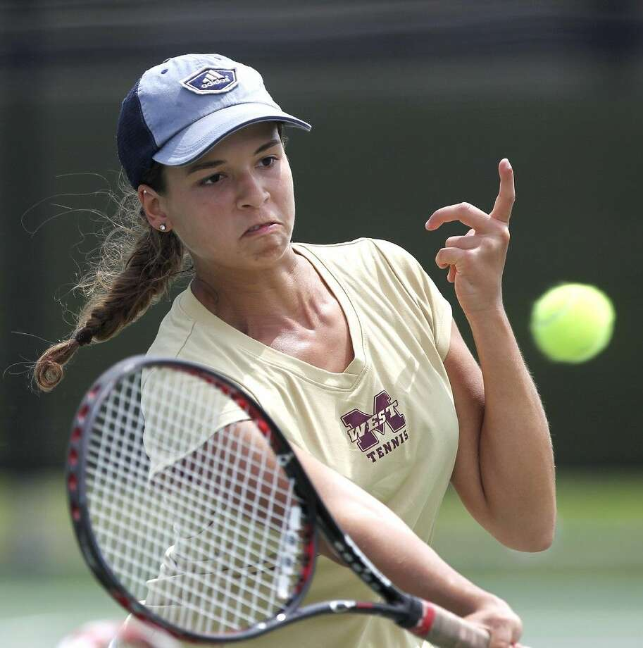 Magnolia West's Corrie Yow returns a shot in the Regional III-5A tennis tournament in Willis Wednesday. To view or purchase this photo and others like it, visit HCNpics.com. Photo: Jason Fochtman