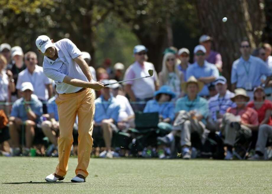 Bill Haas hits off the 15th fairway during the first round of the Masters. Haas leads the tournament after opening with a 68. Photo: Matt Slocum