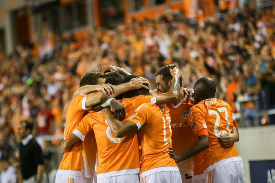 Houston Dynamos celebrate after scoring a goal during the MLS game against FC Dallas on Saturday at BBVA Compass Stadium. Photo: Michael Minasi