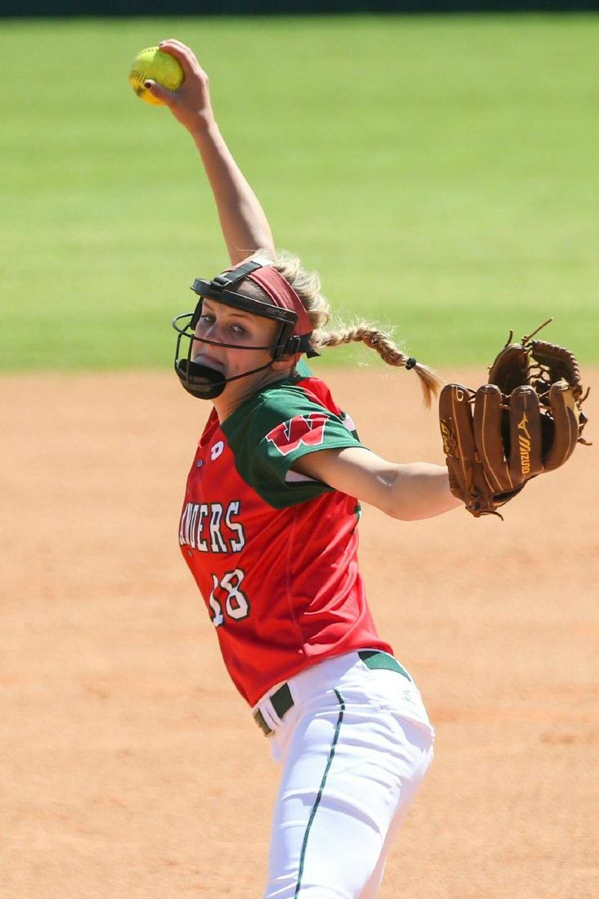 The Woodlands' Emily Langkamp (18) throws a pitch during a high school softball game against College Park on Saturday at The Woodlands High School. To view more photos from the game, go to HCNPics.com.