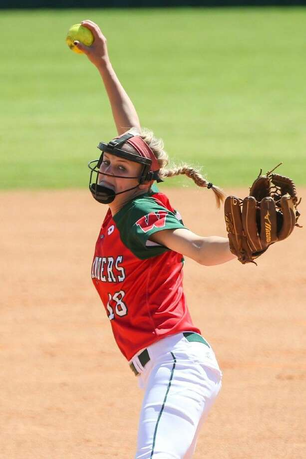The Woodlands' Emily Langkamp (18) throws a pitch during a high school softball game against College Park on Saturday at The Woodlands High School. To view more photos from the game, go to HCNPics.com. Photo: Michael Minasi