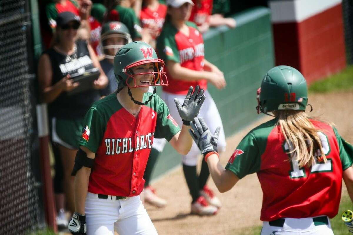 The Woodlands' Skylar Stockton (12) celebrates with teammates after scoring a run during a high school softball game against College Park on Saturday.
