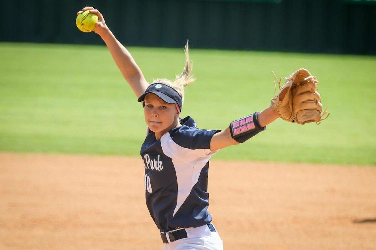 College Park's Julie French (10) throws a pitch during a high school softball game against The Woodlands on Saturday at The Woodlands High School. To view more photos from the game, go to HCNPics.com.