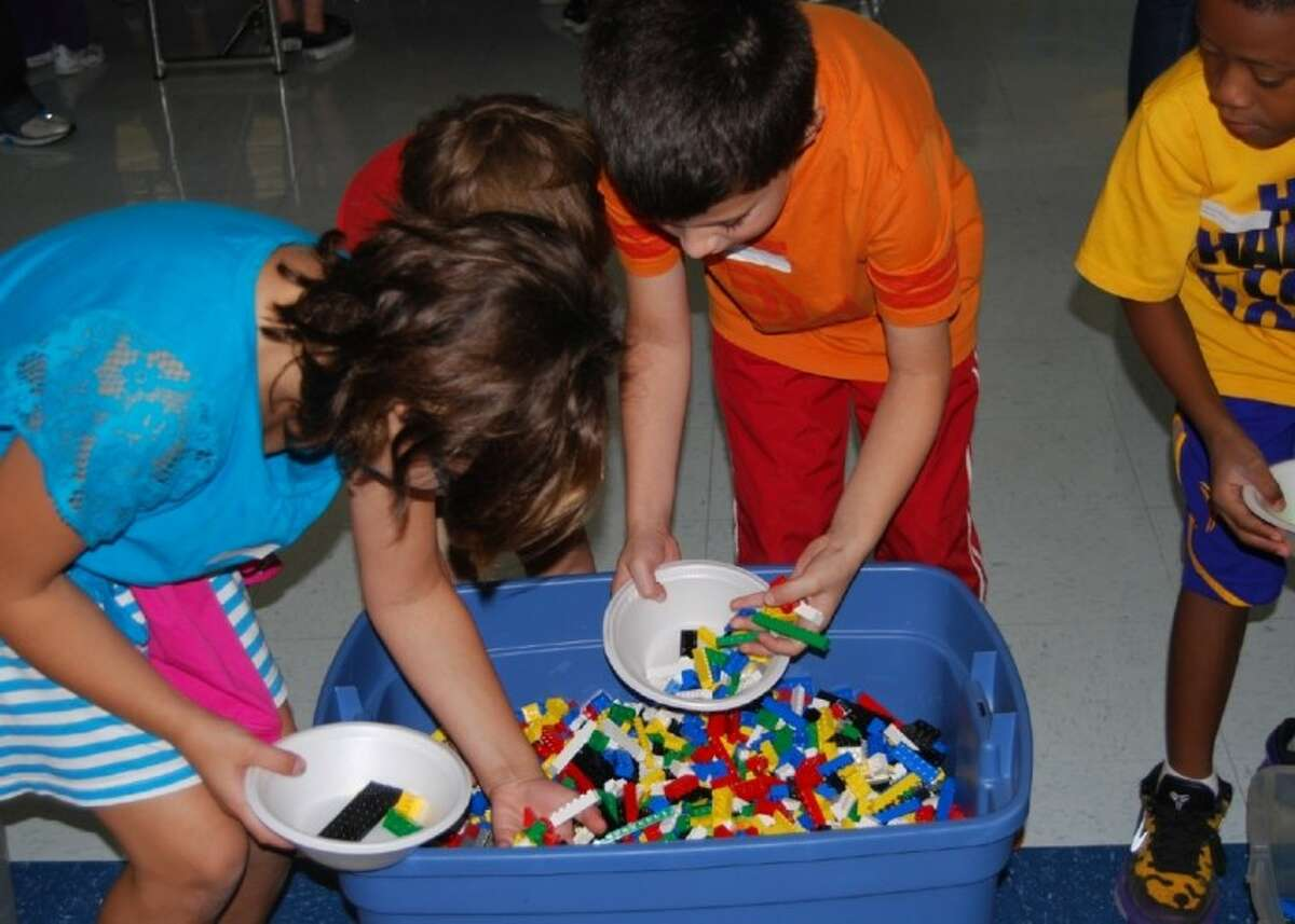 Nearly 200 of Palmer Elementary School students have become members of their school's new Creative Constructors Lego Club, a parent-teacher cooperative created to help students improve their problem-solving and analytical skills.