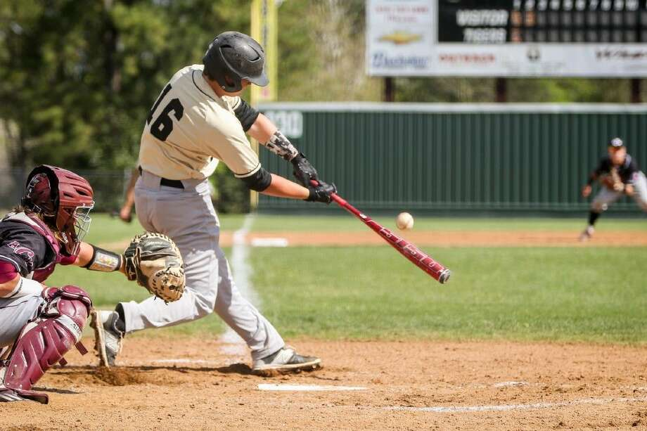 Conroe's Scott Horn (16) takes a swing during a high school baseball game against A&M Consolidated on Saturday at Conroe High School. To view more photos from the game, go to HCNPics.com. Photo: Michael Minasi