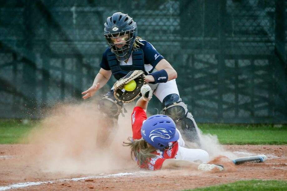 College Park's Kyristen Stockman (9) tags Oak Ridge's Cheyenne Cavanaugh (2) at home plate during a high school softball game on Monday at College Park High School. To view more photos from the game, go to HCNPics.com. Photo: Michael Minasi