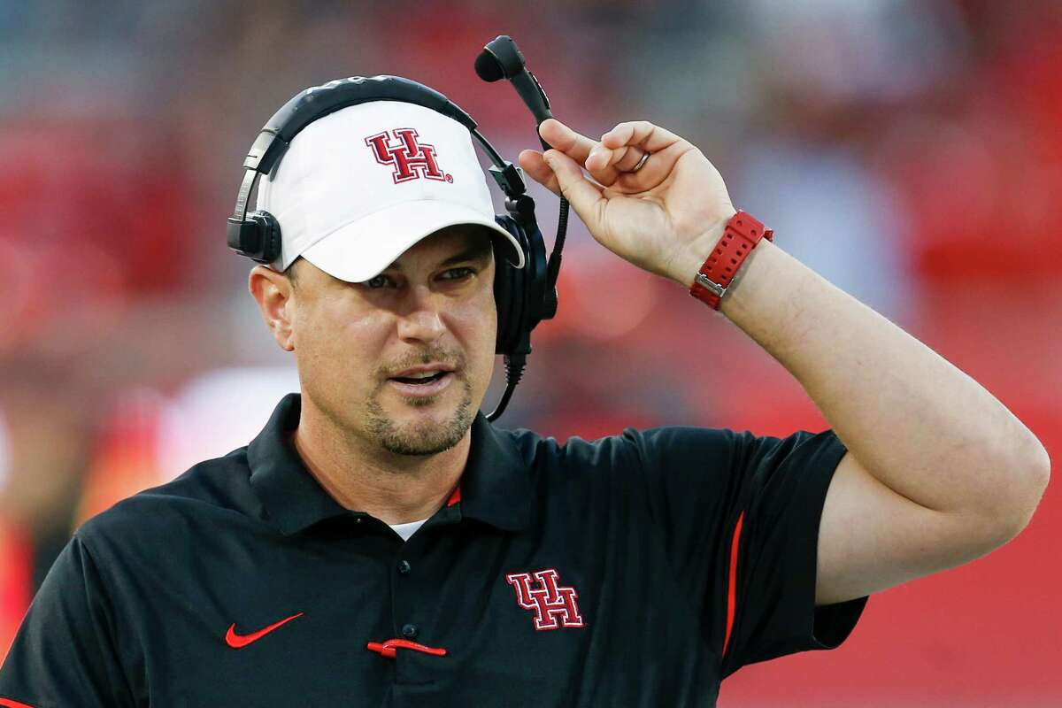 Houston head coach Tom Herman walks up the sidelines during the first quarter of an NCAA football game against Connecticut at TDECU Stadium on Thursday, Sept. 29, 2016, in Houston.