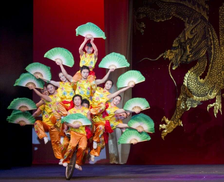 The Peking Acrobats blended their unique brand of acrobatic artistry with the majestic sound of the Houston Symphony last Wednesday. (Photo from a previous performance.)