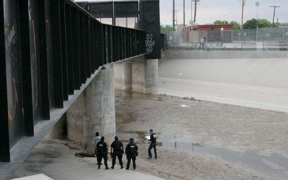 U.S. Border Patrol looks on at a scene where a Mexican teen was shot by an agent in 2010.