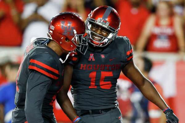 Houston wide receivers Chance Allen (21) and Linell Bonner (15) celebrate Bonner's 4-yard touchdown reception against Connecticut during the third quarter of an NCAA football game at TDECU Stadium on Thursday, Sept. 29, 2016, in Houston.