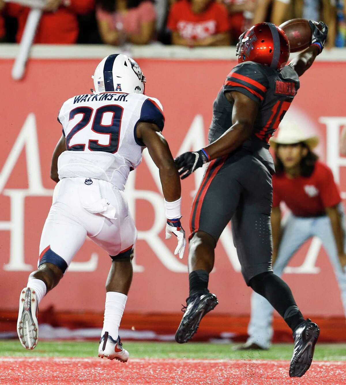 Houston wide receiver Linell Bonner (15) reaches out past Connecticut safety Anthony Watkins (29) to pull down a 4-yard touchdown reception against Connecticut during the third quarter of an NCAA football game at TDECU Stadium on Thursday, Sept. 29, 2016, in Houston.