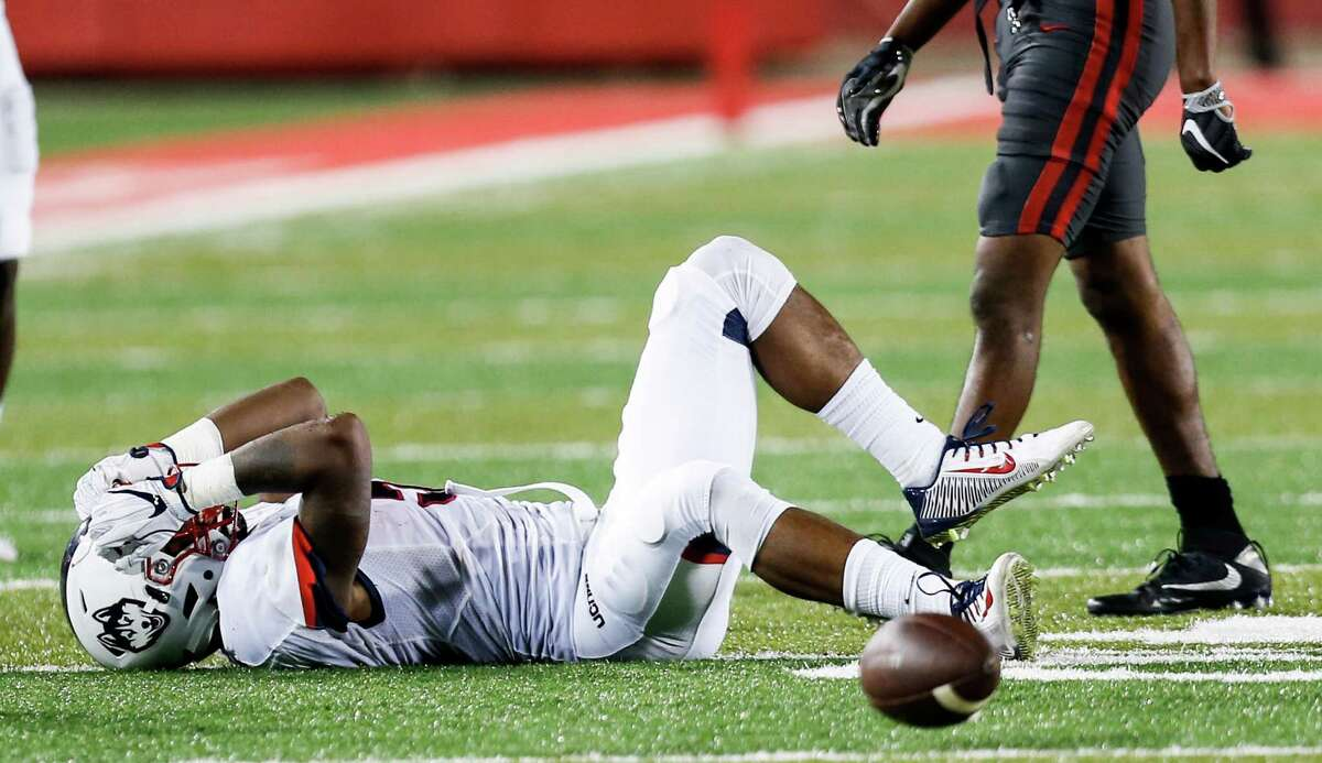 Connecticut wide receiver Noel Thomas (5) reacts after dropping a pass during the third quarter of an NCAA football game against Houston at TDECU Stadium on Thursday, Sept. 29, 2016, in Houston.