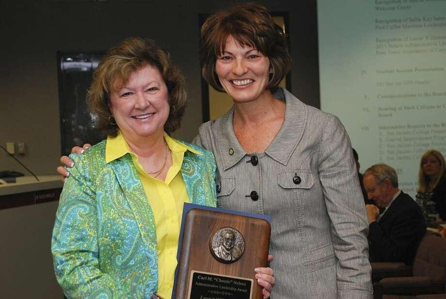 At a recent Board of Trustees meeting, San Jacinto College Chancellor Dr. Brenda Hellyer, right, presented the Carl M. Nelson award to Dr. Laurel Williamson, San Jacinto College deputy chancellor and president.