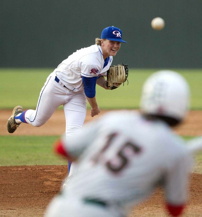 Oak Ridge pitcher Durbin Feltman throws against The Woodlands in a District 16-6A baseball game Friday. To view or purchase this photo and others like it, visit HCNpics.com.