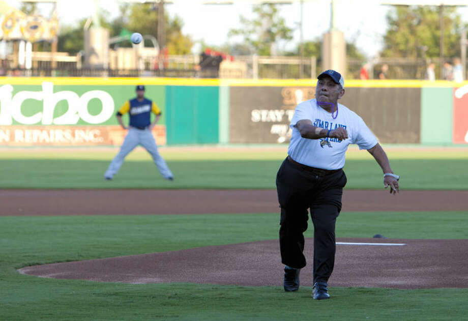 Silverado Sugar Land resident Tony Medina threw the first pitch at Alzheimer's Awareness Night at Skeeters Stadium Sept. 12. Medina, a former professional boxer and skilled race car driver, has lived with Vascular Dementia for the past year. Silverado, an assisted living community that cares for individuals with memory loss in Sugar Land, sponsored the event.