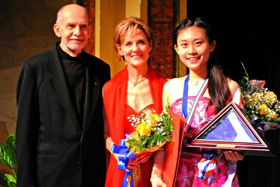 Xuesha Hu, right, who earned the 2016 Young Texas Artists Music Competition's Grand Prize and Gold Medalist in the Piano Division, is shown here with Jim Pokorski, founder, and Susie Pokorski, chair and executive director of YTA.