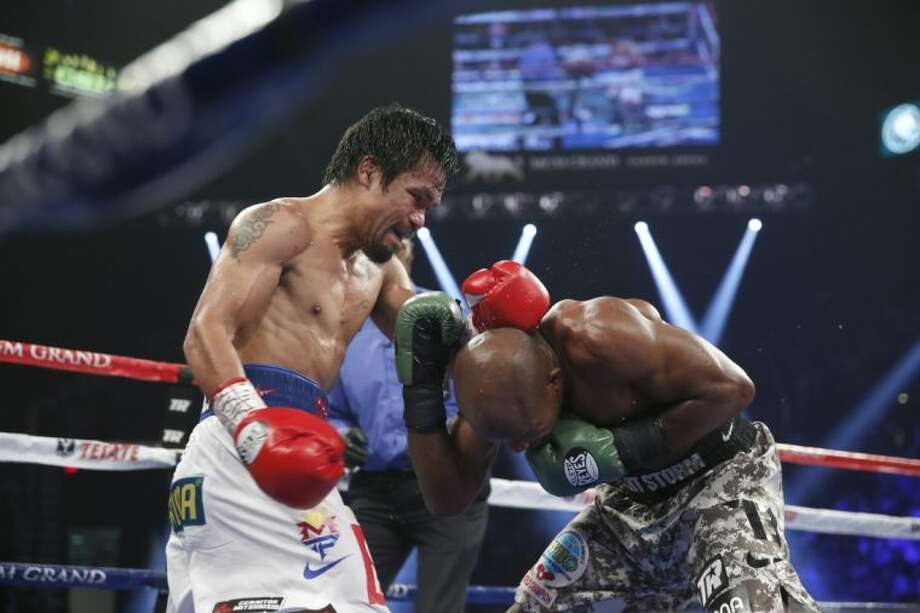 Manny Pacquiao, left, defeated Timothy Bradley on Saturday night. Photo: Eric Jamison