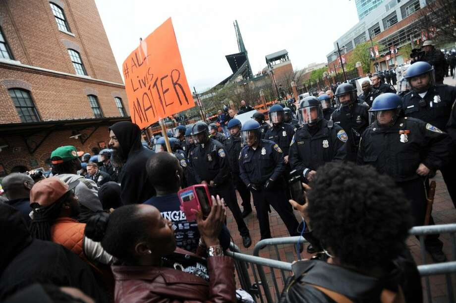 Protestors rally at Oriole Park at Camden Yards during a march for Freddie Gray, Saturday. Photo: GAIL BURTON