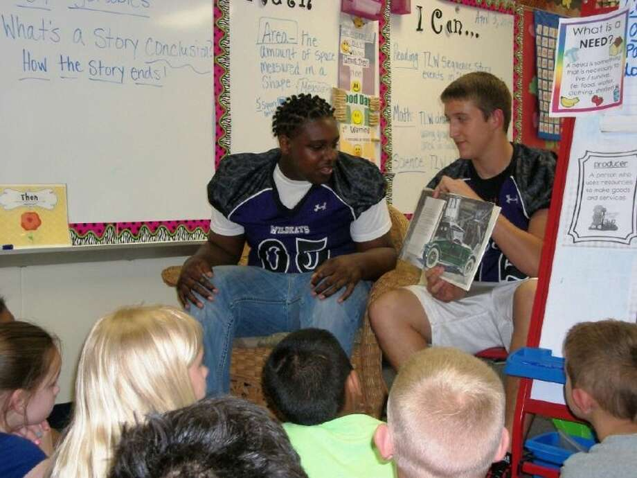 Willis High School football players took time to read to students at Parmley Elementary.