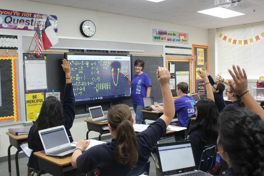 Junior high math teacher Molly Nobile asks students a question while teaching a lesson using the Promethean panels.