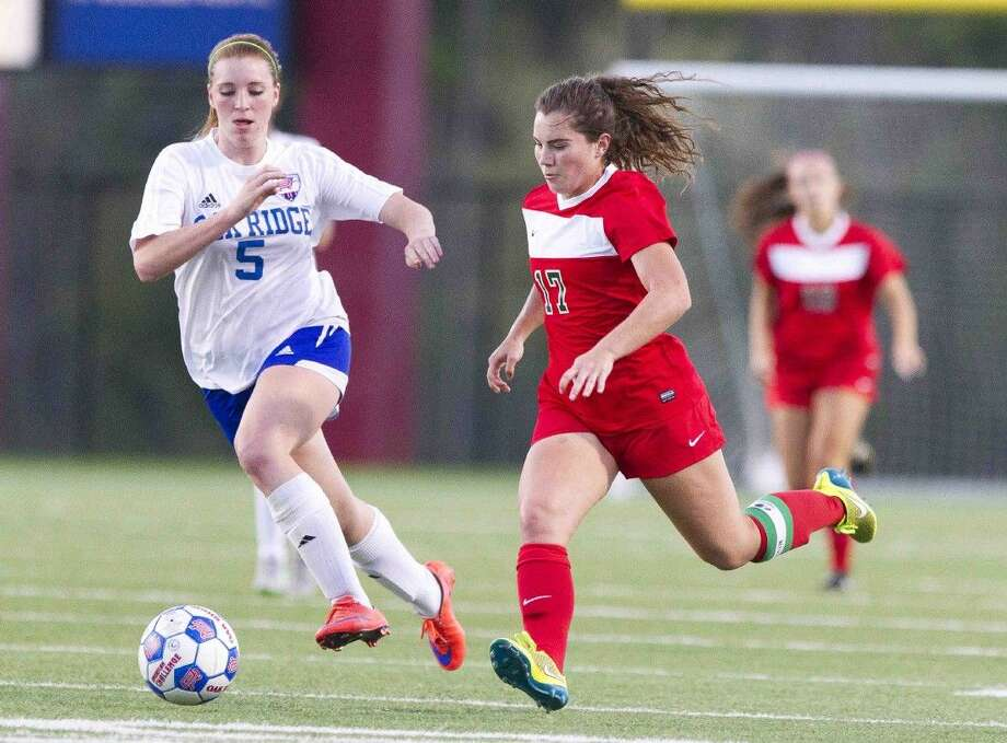 The Woodlands' midfielder Mollie Bond dribbles the ball past Oak Ridge defender Grace Eason during the first half of a District 16-6A girls soccer game earlier this season. Go to HCNpics.com to purchase this photo and others like it. Photo: Jason Fochtman