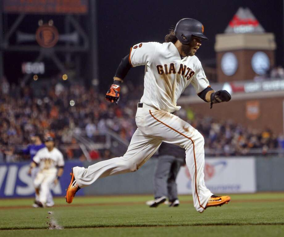 San Francisco Giants' Brandon Crawford scores go-ahed run on Conor Gillaspie's 6th inning sacrifice fly against Colorado Rockies during MLB game at AT&T Park in San Francisco, Calif., on Thursday, September 29, 2016. Photo: Scott Strazzante, The Chronicle