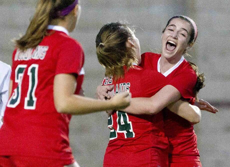 The Woodlands midfielder Jessica Reeg, right, celebrates a goal by Sally Branigan during the first period of a District 16-6A girls soccer game Friday. Go to HCNpics.com to purchase this photo, and others like it. Photo: Jason Fochtman