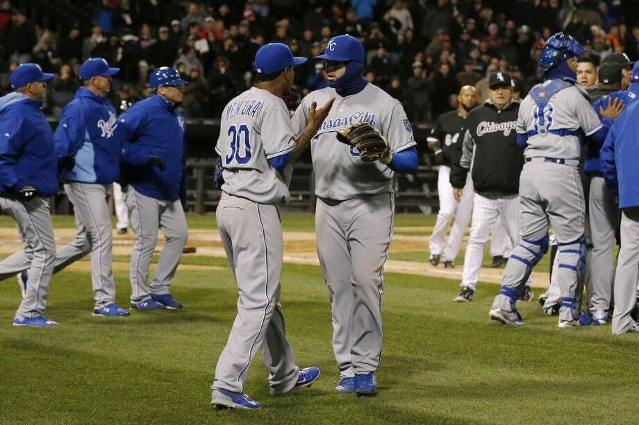 Kansas City Royals starting pitcher Yordano Ventura is pulled aside by teammate Mike Moustakas as the benches clear Thursday in Chicago.