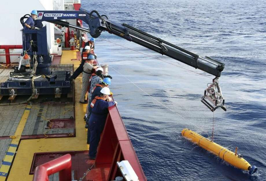 In this April 14 photo provided by the Australian Defense Force an autonomous underwater vehicle is deployed from ADV Ocean Shield in the search of the missing Malaysia Airlines Flight 370 in the southern Indian Ocean.