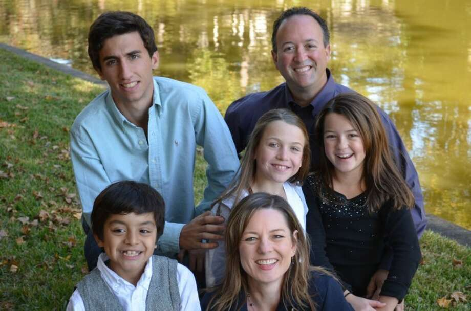 Spain foreign exchange student Jorge Vizarraga, top left, with his host family, the Shanahans, who were matched through the Ayusa Exchange Student Program.
