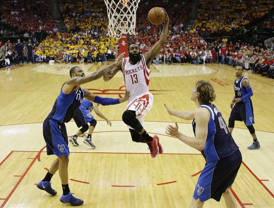 Houston Rockets' James Harden puts up a shot during the first half of Game 5 against the Dallas Mavericks on Tuesday in Houston. Photo: David J. Phillip