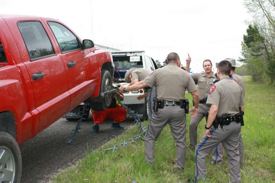 Suspect's vehicle is picked up by a wrecker at the end of the pursuit. Photo: Vanesa Brashier/Cleveland Advocate