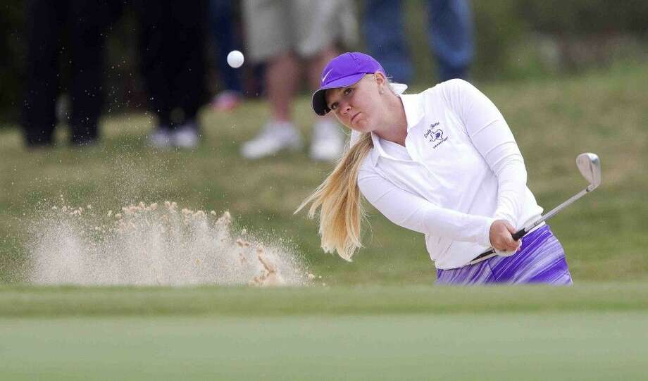 Montgomery's Hailee Cooper hits out of a bunker near the 10th green. To view or purchase this photo and others like it, visit HCNpics.com. Photo: Jason Fochtman
