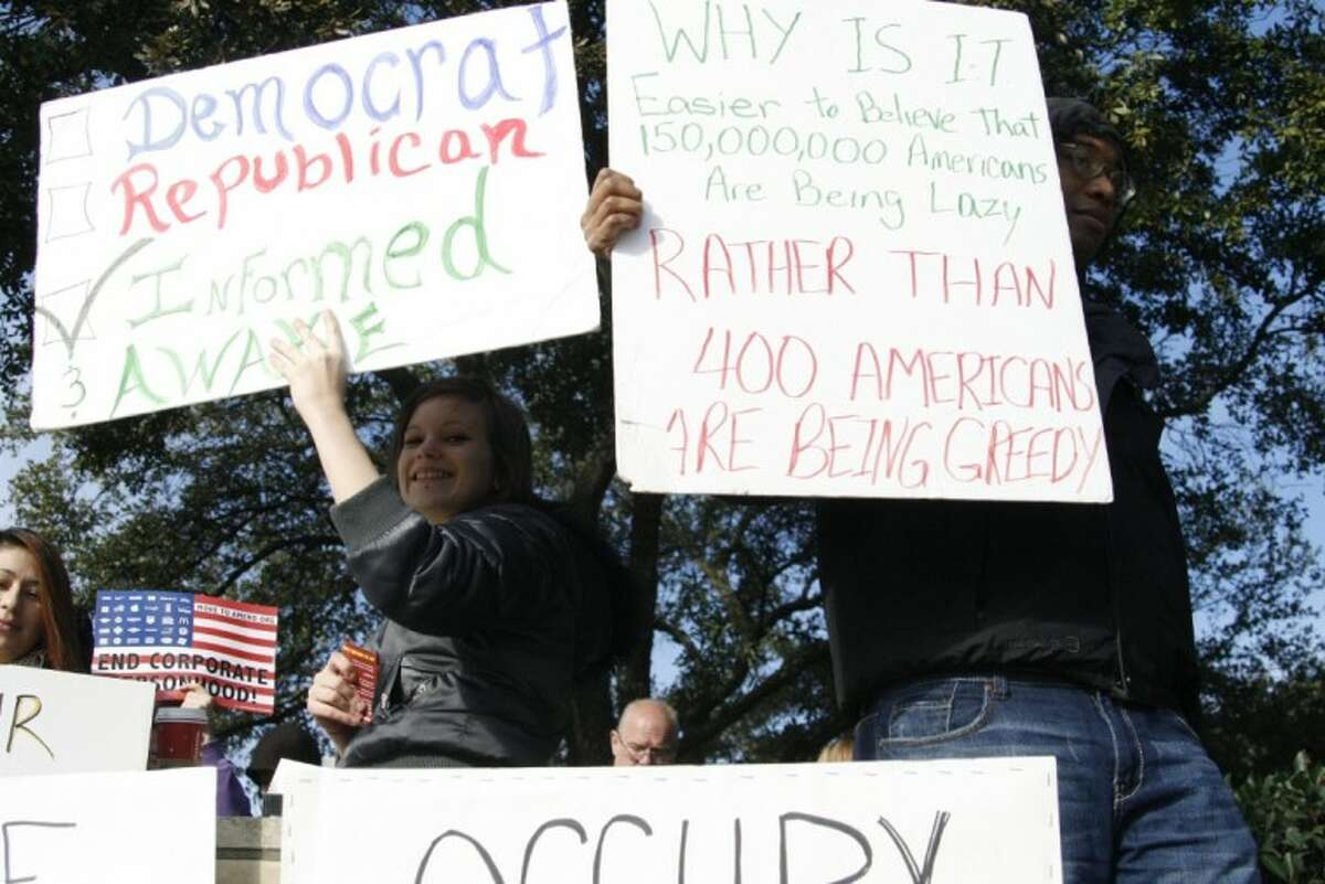 Every Saturday for the past 52 weeks, a group of residents have occupied the corner of West Lake Houston Parkway and Kingwood Drive for their own Occupy Kingwood.