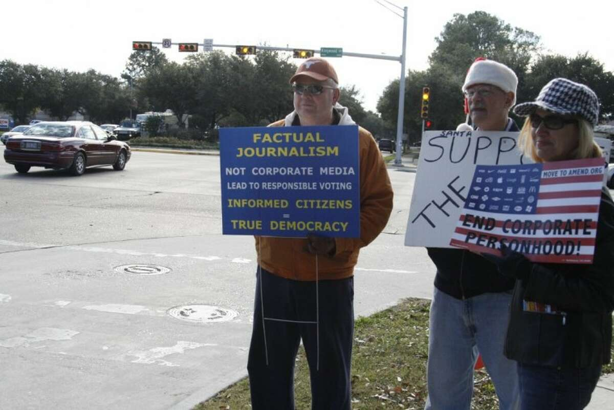 More than 50 community members and members of the Kingwood Democrats staged their last Occupy Kingwood Dec. 29 to hold signs and share information with passerby.