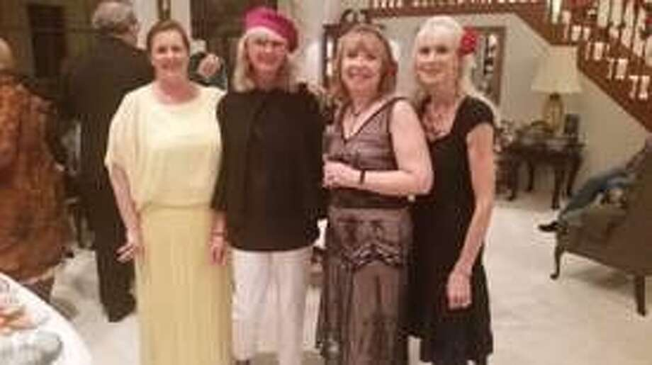 "Members of The Woodlands Chorale sang at gala fundraiser ""An Evening in Paris"" Feb.y 13. From left are Anne Campbell, Nanette Power Goodrich, Valerie Woller and Sandy Max Windsor."