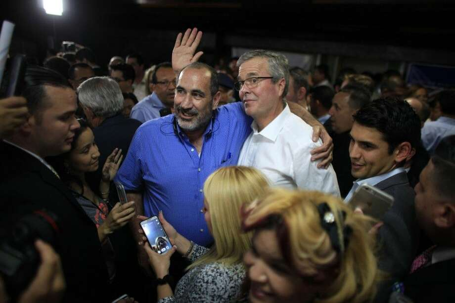 Former Florida Gov. Jeb Bush poses for pictures with supporters after holding a town hall meeting with Puerto Rico's Republican Party on Tuesday in Bayamón. Photo: Ricardo Arduengo