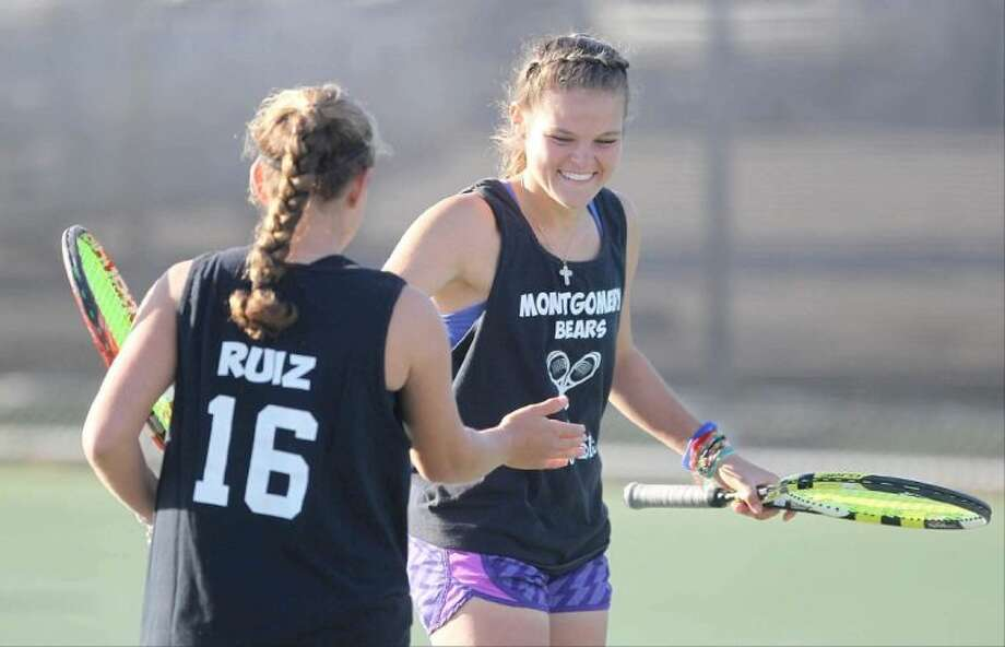 Montgomery's Erika Richarme celebrates with doubles partner Valerie Ruiz after a set during the Region III-4A regional tennis tournament in Willis Wednesday. Richarme and Ruiz won the tournament. To view or purchase this photo and others like it, visit HCNpics.com. Photo: Jason Fochtman