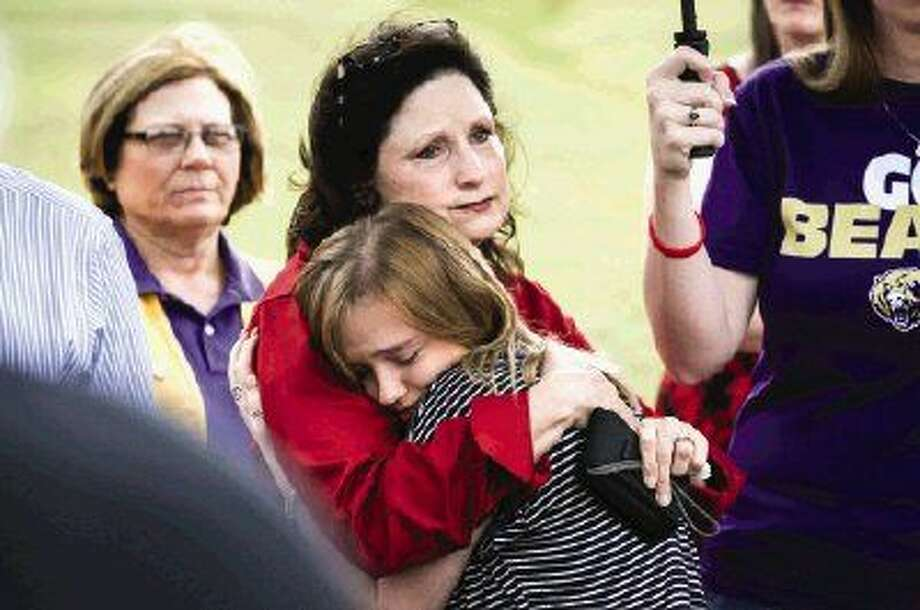 Cindy Cummings, grandmother of Trenton Fortune, consoles Maddie Pratt, Fortune's girlfriend at the time of his death, during a tree dedication ceremony for Fortune and Grant Hobson, who also died in February, on Saturday at Montgomery High School. Photo: Michael Minasi