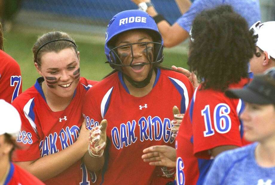Oak Ridge's Aiyana Freeney, center, celebrates after hitting a three-run home run in the second inning of a District 16-6A softball game Tuesday. Go to HCNpics.com to purchase this photo and others like it. Photo: Jason Fochtman