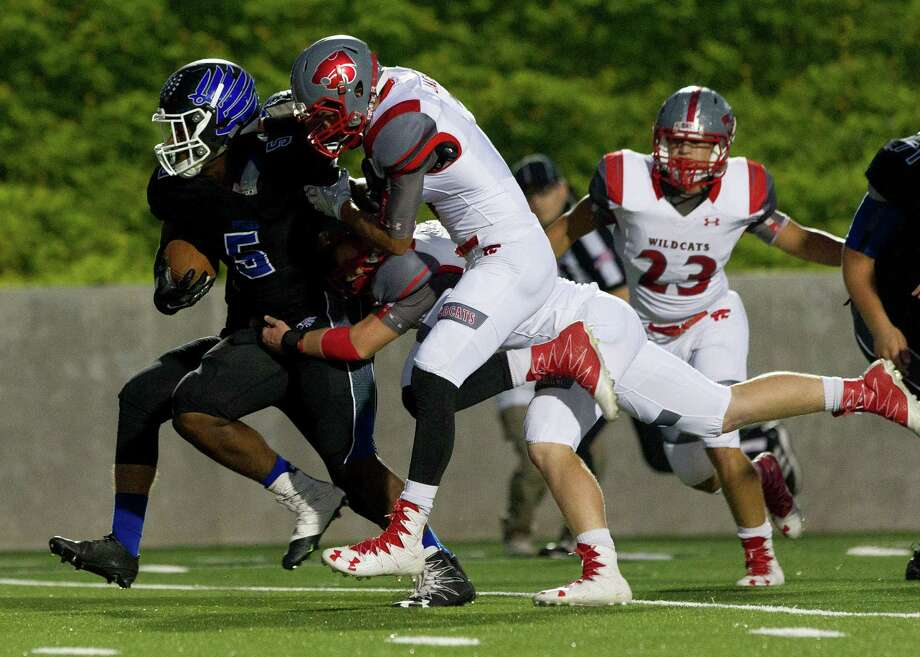 New Caney running back Mart'e Allison (5) carries a pair of Splendora defenders into the end zone for a 17-yard touchdown run, one of three TDs by Allison. Photo: Jason Fochtman, Staff / Houston Chronicle