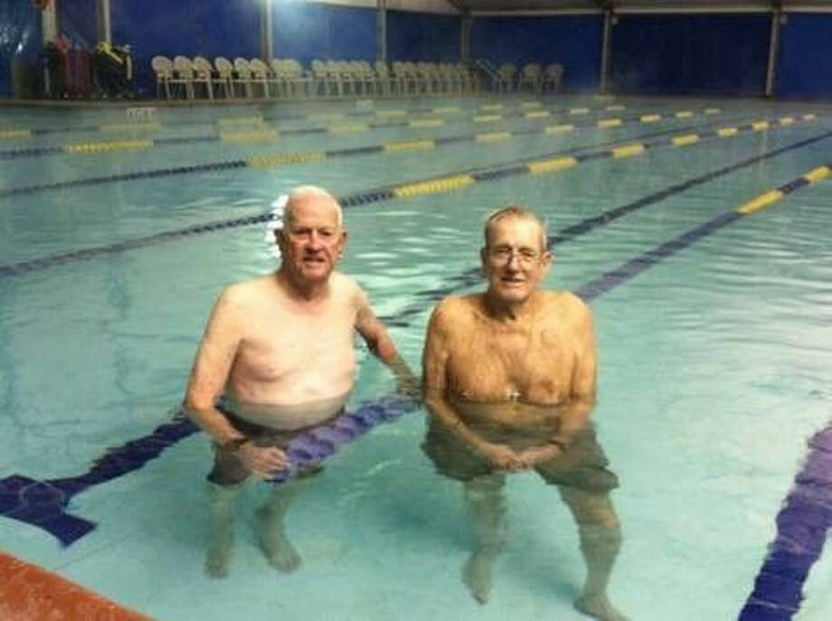 Glen Finkbiner, left, and Claude Wallace have water walked at the City of Conroe Aquatic Center for 20 years. They have water walked over 10,000 miles together at the City of Conroe Aquatic Center. That's the equivalent of walking across the continental United States 3 ½ times.